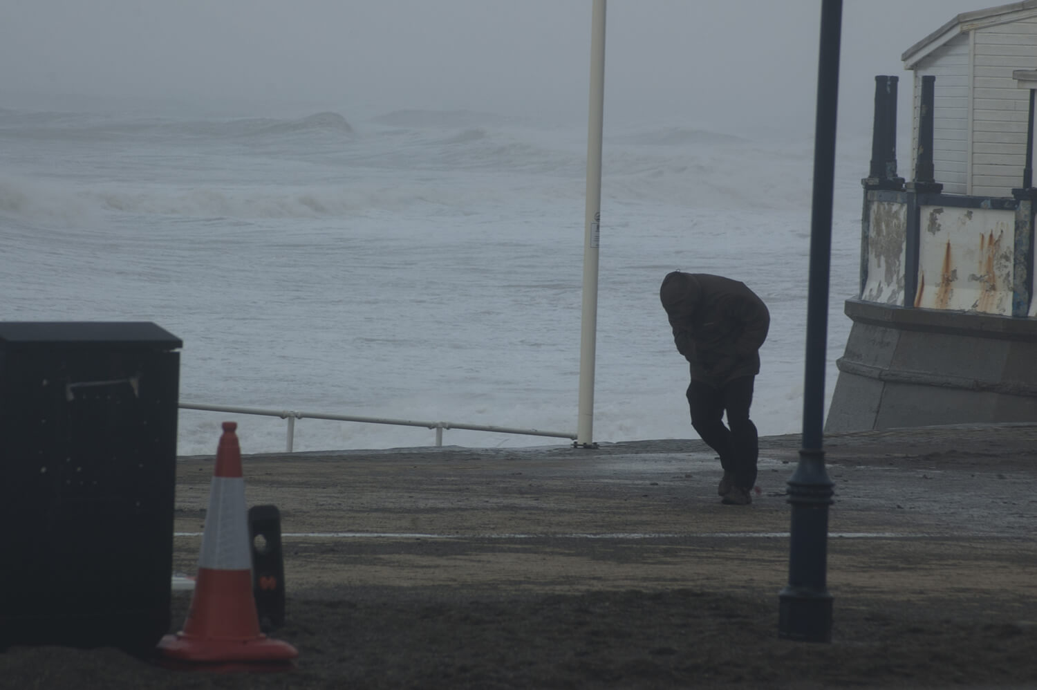 CE Aberystwyth storms man on the promenade battling the high winds